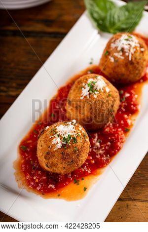 Arancini, Stuffed Italian Rice Balls Coated With Bread Crumbs