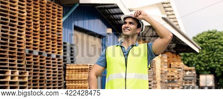 Banner Of Young Indian Worker Working In Logistic Industry Outdoor In Front Of Factory Warehouse. Sm