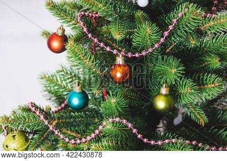 Christmas Background - Baubles And Branch Of Artificial Spruce Tree