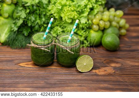 Detox Diet Concept. Healthy Green Smoothie With Spinach In A Jar. Glasses With Green Organic Smoothi