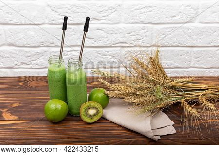 Green Cocktail Spinach Smoothie In A Glass. Smoothie Juice On Wooden Table With Cereals And Kiwi. Sp