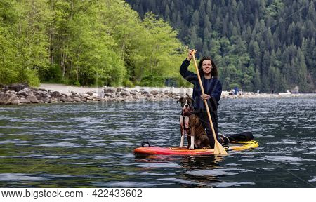 Adult Caucasian Adventure Woman On A Paddle Board With Boxer Dog. Alouette Lake In Golden Ears By Ma