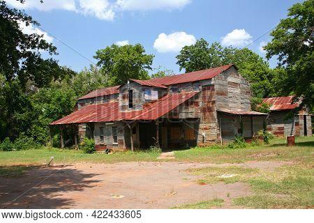 Rustic Rural Barn With American Flag In Rural East Texas