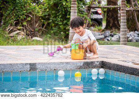 Asian Boy Son Children Playing Pool Toys Poolside Happy Learning Life With Family Fun To Learn And P