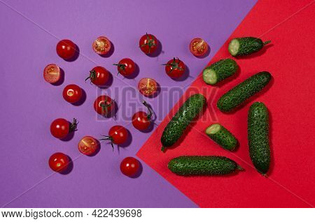 Juicy Red Tomato, Green Young Cucumber With Shadow On Contrast Red And Purple Background. Modern Foo