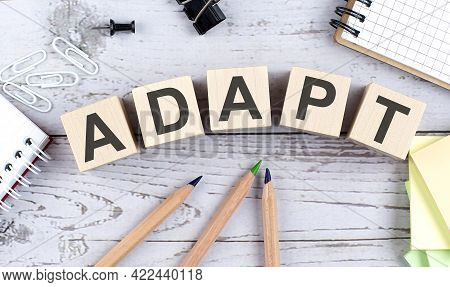 Adapt Text On Wooden Block With Office Tools On Wooden Background