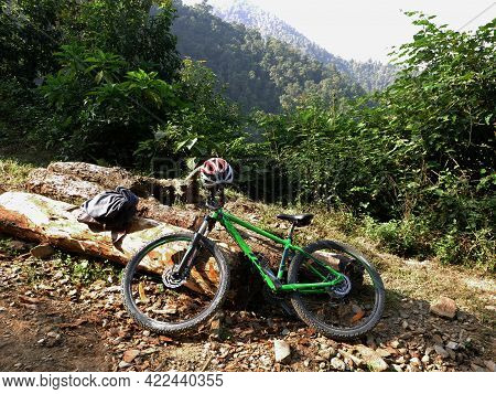 Nepali People Or Foreign Travelers Riding Biking Mountain Bike Or Mtb And Stop Rest On Gravel Street