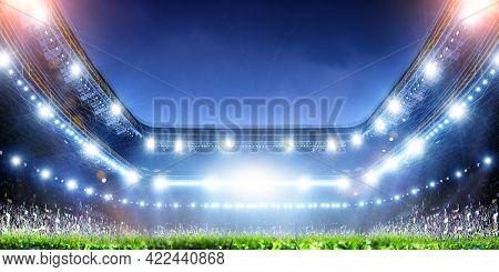 Full night football arena in lights . Mixed media