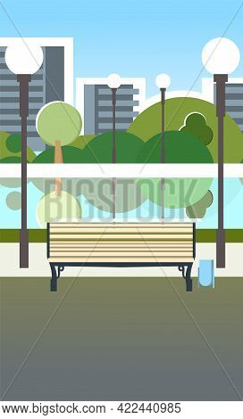 Bench And Pond. City Park Area. Trees, Shrubs And Lanterns. Beautiful Summer Cityscape In Restrained