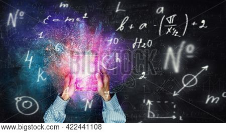 Formulas on blackboard background . Mixed media