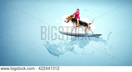 Little girl on the dog riding a surf board . Mixed media