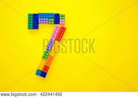 Figure One Of The Children\'s Multi-colored Constructor On A Yellow Background. Empty Space For The