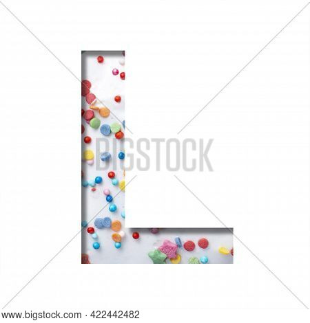 Sweet Glaze Font. The Letter L Cut Out Of Paper On The Background Of White Sweet Glaze With Colored
