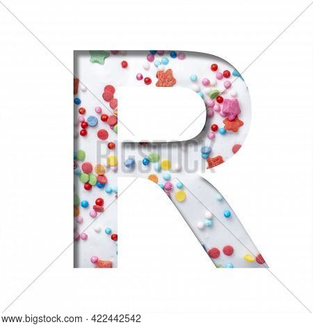 Sweet Glaze Font. The Letter R Cut Out Of Paper On The Background Of White Sweet Glaze With Colored