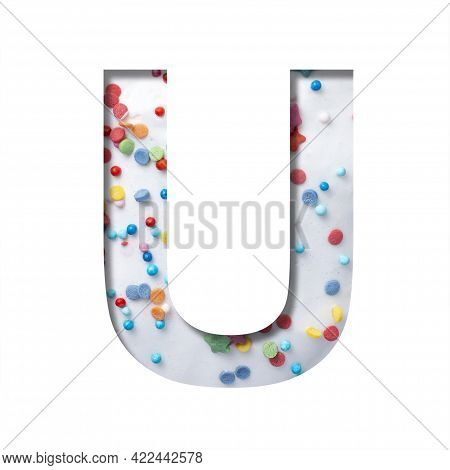 Sweet Glaze Font. The Letter U Cut Out Of Paper On The Background Of White Sweet Glaze With Colored