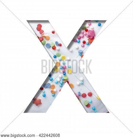 Sweet Glaze Font. The Letter X Cut Out Of Paper On The Background Of White Sweet Glaze With Colored