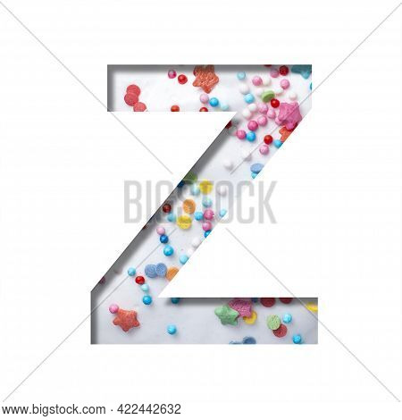 Sweet Glaze Font. The Letter Z Cut Out Of Paper On The Background Of White Sweet Glaze With Colored