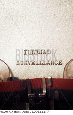 Illegal surveillance phrase written with a typewriter.