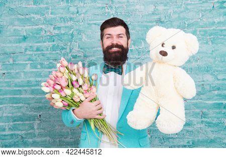 Macho Getting Ready Romantic Date. Man Wear Blue Tuxedo Bow Tie Hold Flowers Bouquet. International