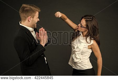 Confrontation By Force. Angry Woman Throw Punch At Male Colleague. Workplace Conflict. Challenging R