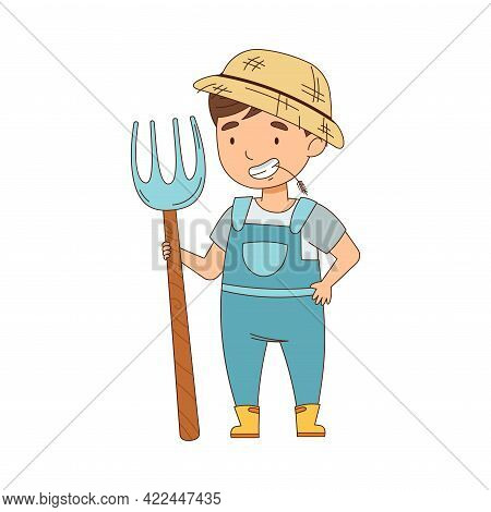 Little Boy As Farm Worker In Overall And Straw Hat Standing With Pitchfork And Chewing Grass Vector