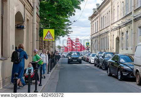 Saint-petersburg, Russia - June 1, 2021: People On The Street Leading To The Neva River, Where Is A