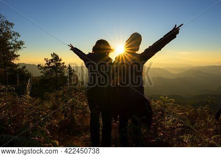 Lifestyle Traveler Women Happy Feeling Good Relax And Freedom Facing  In The Sunrise Morning. Travel