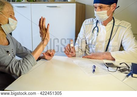 Caring Doctor Helps A Negative Elderly Grandmother Of 85 Years-a Patient At Home Or In The Hospital.