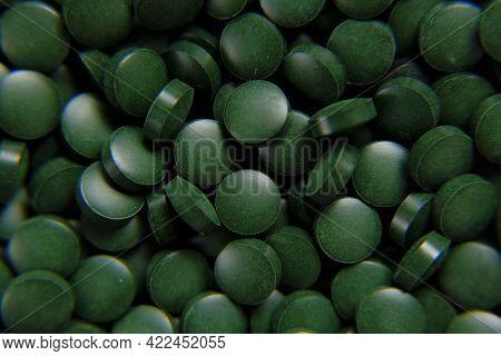 Spirulina Green Pills Background. Spirulina Algae Green Tablets.