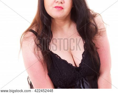 Plus Size Fat Woman Wearing Black Lace Lingerie Showing Her Chest Breasts. Bosom Concept.