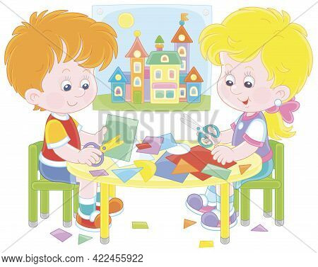 Happy Little Children Cutting Outlines And Figures From Color Paper With Scissors And Making A Funny