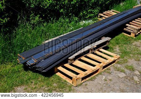 Steel Strips Used As A Construction Material For The Creation Of Curbs Forming Park Paths In The Gar