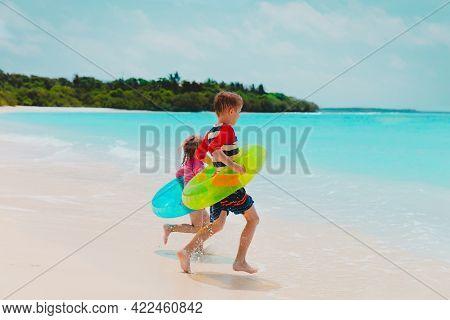 Happy Kids- Boy And Girl- Go Swim On Beach