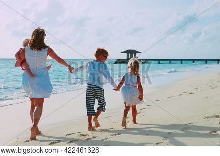 Mother And Kids Enjoy Beach Vacation, Family Have Fun
