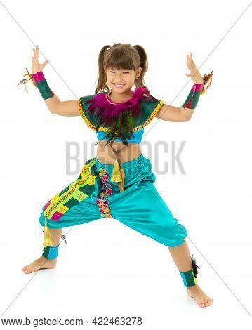 Girl Having Fun In Festive Costume. Beautiful Preteen Girl Dressed Colorful Ethnic Dance Costume Sta