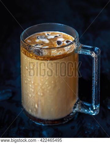 Frappe Coffee In Tall Glass Mug On Dark Background