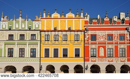 View Of Colorful Buildings In The Historic Great Market Square At Zamosc, Poland. Photo Taken On A S