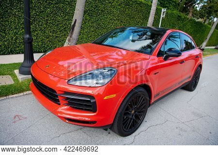 Palm Beach, Florida Usa - March 21, 2021: Orange Porsche Cayenne Coupe Luxury Car