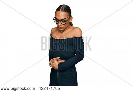 Hispanic transgender man wearing make up and long hair wearing women clothes with hand on stomach because indigestion, painful illness feeling unwell. ache concept.