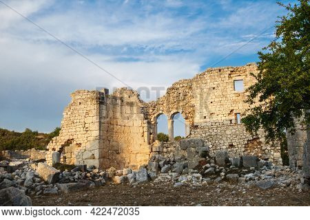 Ruins Of Building Lighted By Sunset Lights In Ancient City Kanli Divane Or Canytelis, Ayaş, Turkey.