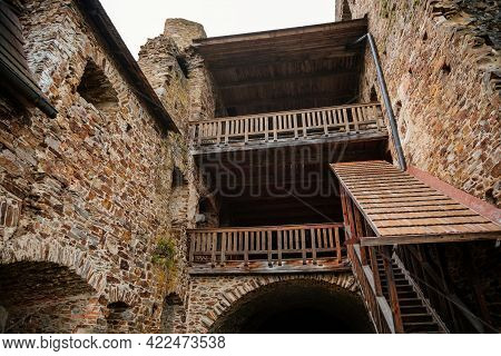 The Interiors Of Gothic Medieval Castle Tower, Wooden Stairs And Floors, Fortress Masonry Wall, Old