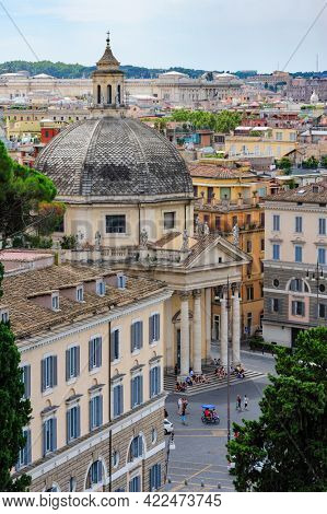 Rome, Italy, August 2014: View of piazza del Popolo in Rome crowded with tourists. Santa Maria in Montesanto and Santa Maria dei Miracoli basilics