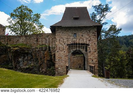 Gothic Medieval Castle Velhartice In Sunny Day, Tower And Entrance Gates With Arch, Moat Around Stro