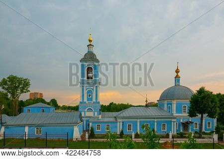 Golden Domes With Crosses Of An Orthodox Temple On The Background Of Bright Blue Sky. Snow-white Fac