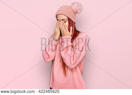 Young caucasian woman wearing casual clothes and wool cap rubbing eyes for fatigue and headache, sleepy and tired expression. vision problem