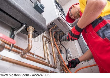 Professional Gas Heating Technician With Natural Gas Detector Device In His Hands Looking For Potent
