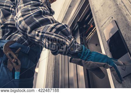 Professional Technician Calling For Elevator. Scheduled Warranty Maintenance Of Residential Elevator
