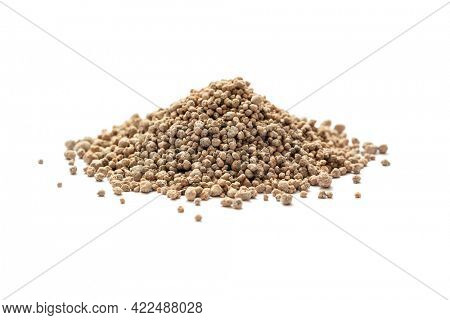 Heap of mineral fertilizers on white background