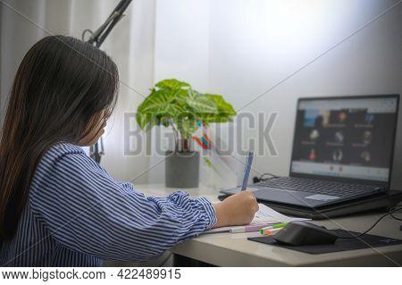 Asian Girl Doing Homework Or Online Education