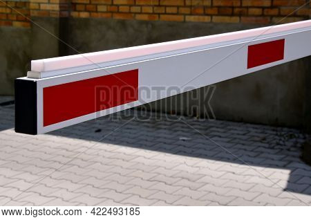 Traffic Barrier To The Yard With Led Light Strip. Striped Aluminum Barriers Are Controlled By Automa